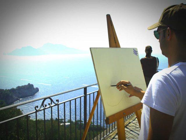 man painting scenery